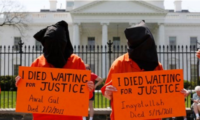 Guantánamo Bay rally – activists protest in front of the White House demanding President Obama close the US prison camp earlier this year. Now, the military acknowledges that the withholding of information is a deliberate move to undermine public knowledge of a protest that has garnered international support. (Photograph: Larry Downing/Reuters)